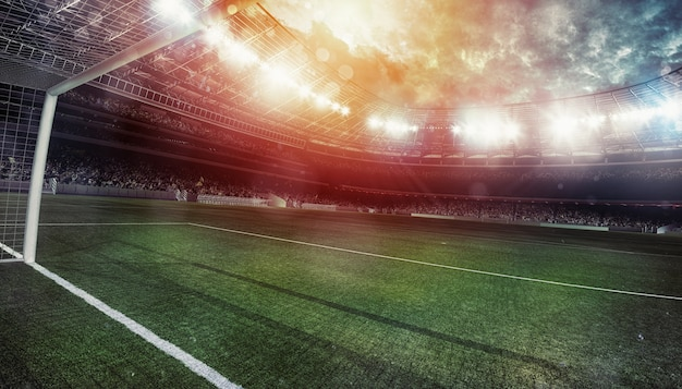 選手なしで試合を待っているファンでいっぱいのスタンドがあるサッカースタジアムdレンダリング