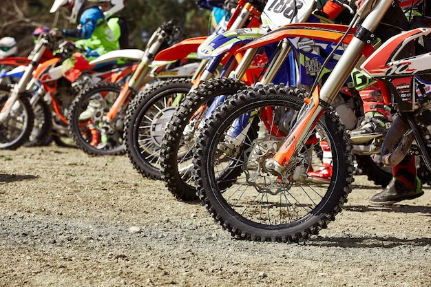 Sochi, russia - 04.04.2018: young riders on motorcycles at starting line during cup winter motocross