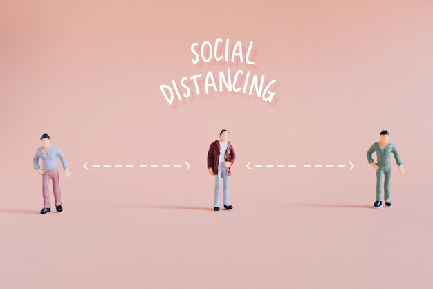 Social distance concept, miniature people standing keep distance in public