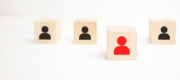 Social distance covid-19, human resource management and recruitment business concept. wooden cube blocks are different with human icons, red, prominent crowds
