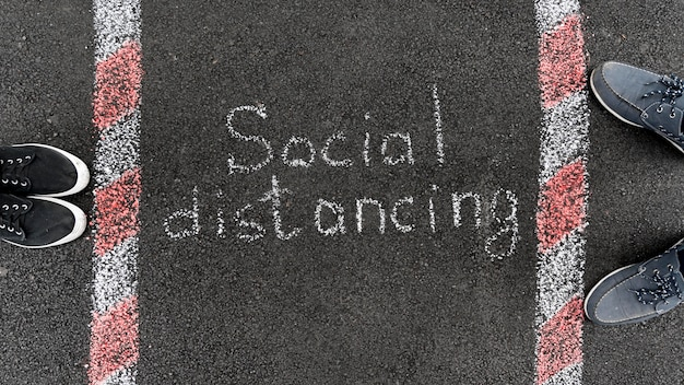 Social distancing concept with chalk