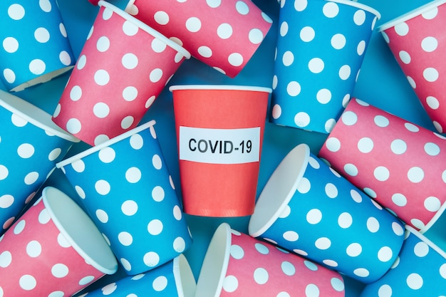 Social distancing on the example of cardboard cups. coronavirus epidemic. the quarantine, the self-isolation. covid-19