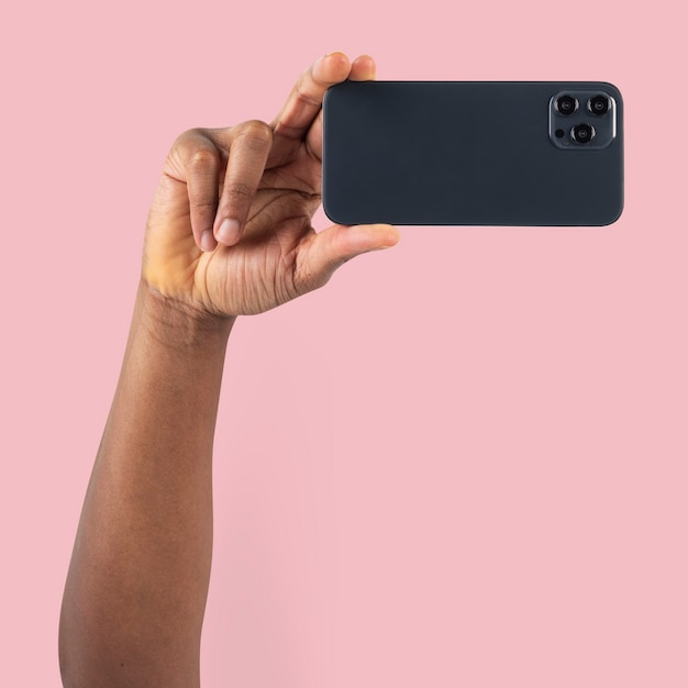 Social media audience person filming through smartphone