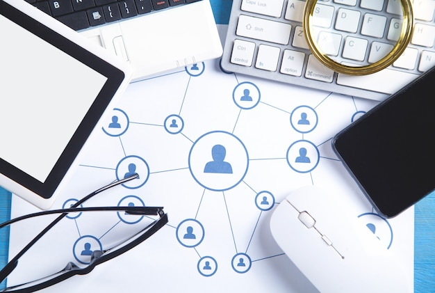 Social media networking. network connection. smartphone, tablet, computer keyboard, mouse.