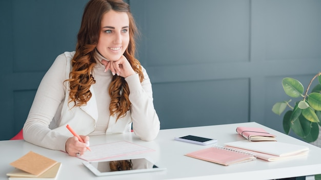 Social network business. internet marketing. smm woman at workplace making notes in schedule.