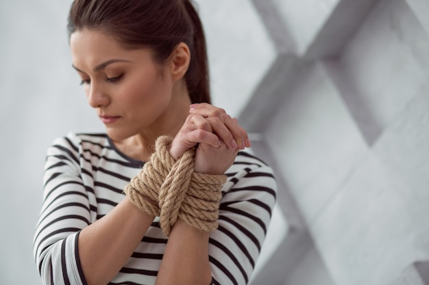 Social problem. selective focus of tied up hands of a beautiful nice young woman