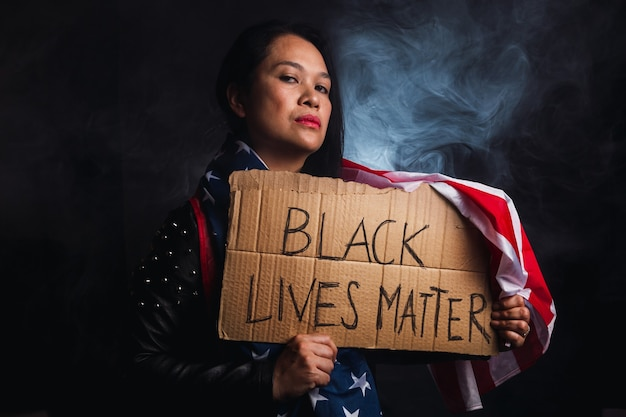 The social problems of racism - black lives matter, woman holding this message.