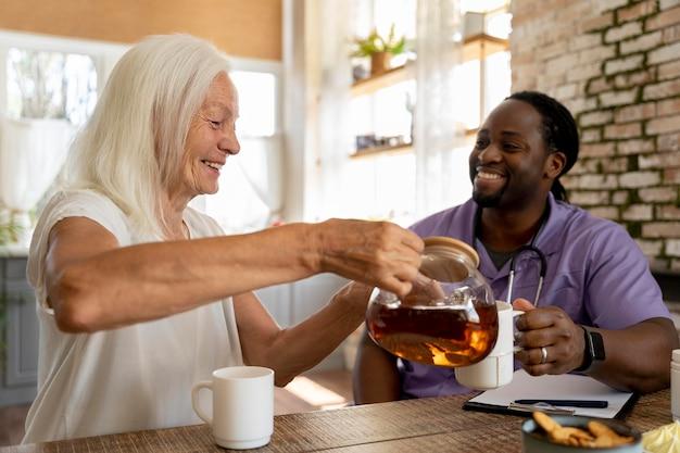 Social worker helping a senior woman