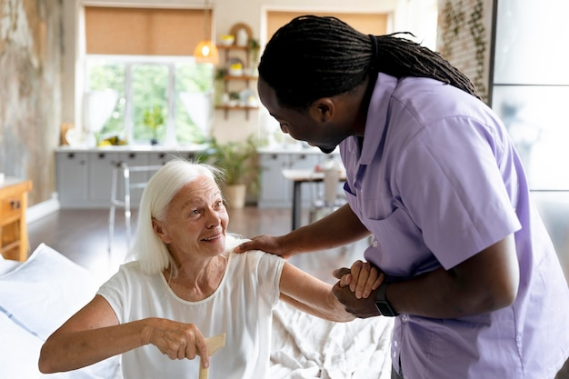 Social worker taking care of an old woman