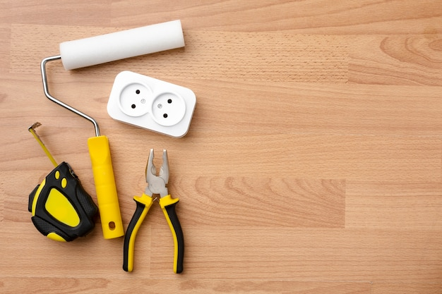 Socket and tools on wooden background