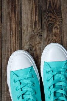 Socks of shoes on wooden floor