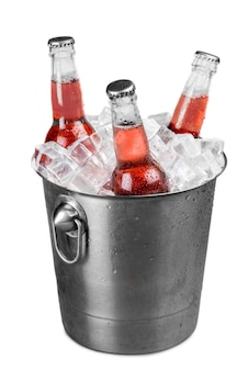 Soda bottles in a bucket filled with ice.