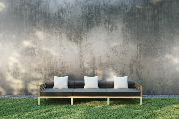 Sofa in the garden on the grass with gray wall
