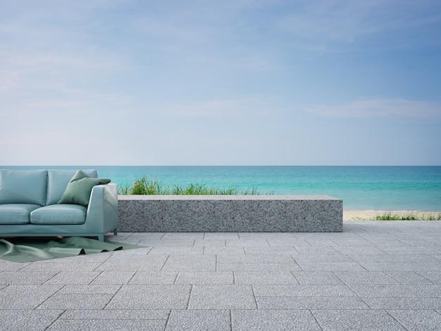 モダンなビーチハウスの庭の近くの屋外テラスのソファ
