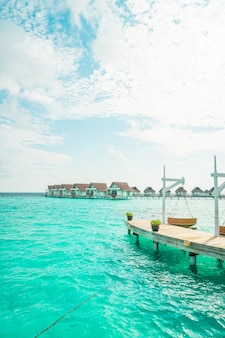 Sofa swing with tropical maldives resort and sea