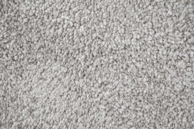 Мягкая коврик для ванной текстильная структура. серый ковер крупным планом фото.