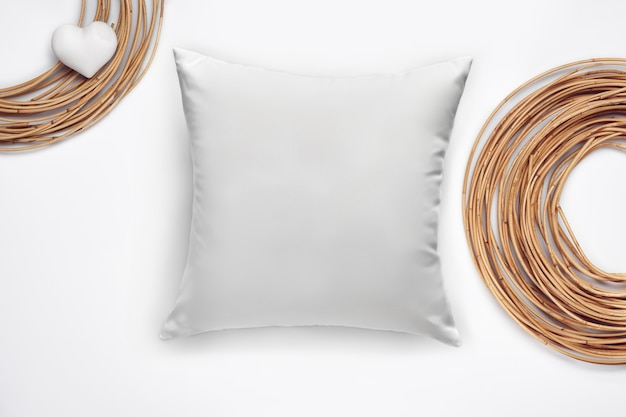 Soft blank pillow, dried osier or willow rolled into a circle