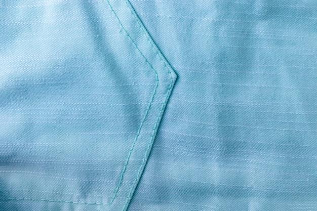 ソフトブルー、ターコイズコットン生地のテクスチャ背景、ステッチされた斜めのストライプとポケット付き