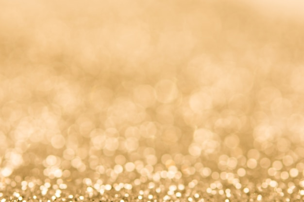 Soft blurred golden color glitter bokeh