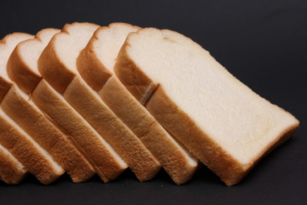 Soft bread with a black background.