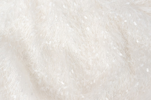 A soft cozy plaid dress of fleecy, with a long pile textile. the texture of the shaggy white fabric with a pile, evenly spread out.