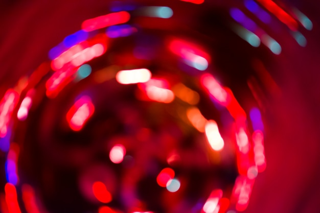 Soft defocused red holidays light background. red bokeh holiday glitter background