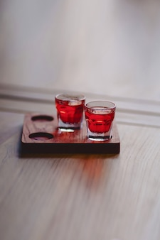 Soft drink of tender red in stacks on a wooden stand