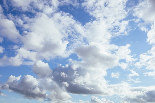 Soft and fluffy clouds formation on the bright sunny blue sky nature abstract background fresh air weather concept