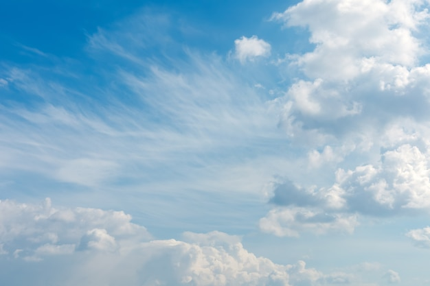 Soft and fluffy clouds formation on the bright sunny blue sky nature abstract background fresh air weather and freedom concept