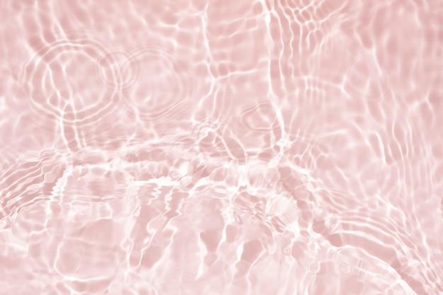 Мягкий фокус косметический увлажняющий крем розовый цветочный водный мицеллярный тоник лосьон или эмульсия абстрактный фон