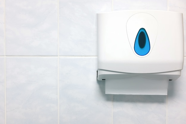 Soft focus paper towel dispenser on a granite wall in the bathroom