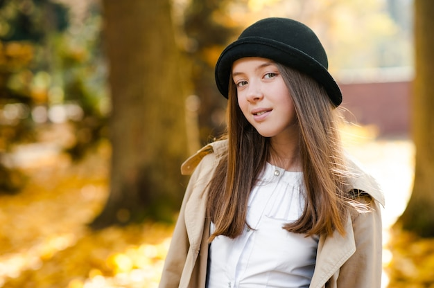 Soft focus portrait of a cute teen in the park