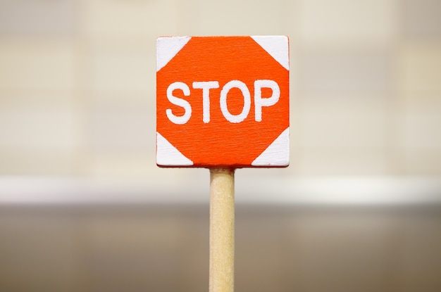 Soft focus shot of a stop sign on the road