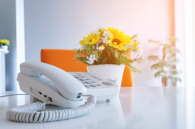 Soft focus on telephone devices at office desk with light effect
