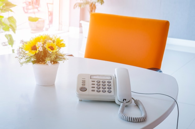 Soft focus on telephone devices at office desk