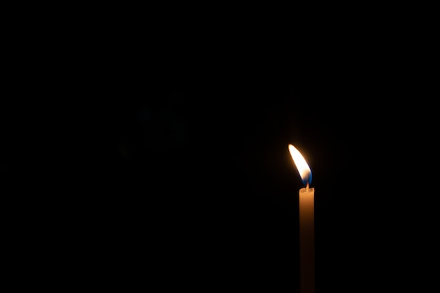 Soft focused candles light in dark night