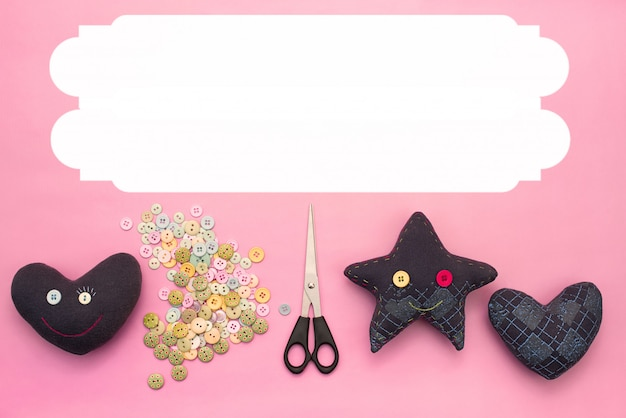 Soft handmade toys. materials for artistic buttons, scissors, toy star.