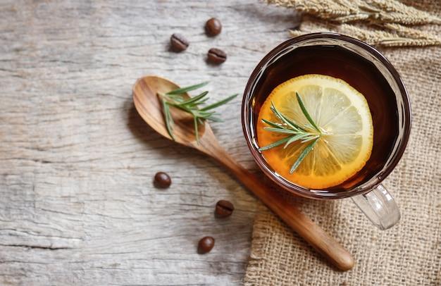 Soft hot coffee tea with  lemon and rosemary
