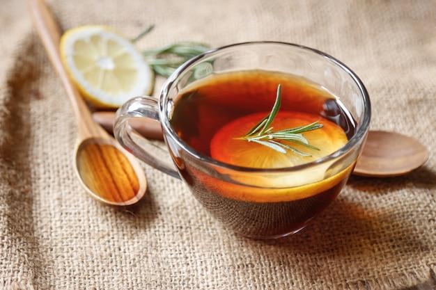 Soft hot tea with  lemon and rosemary