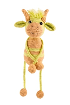 Soft knitted bull on a white