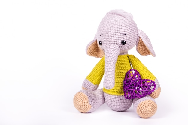 Soft knitted elephant and heart