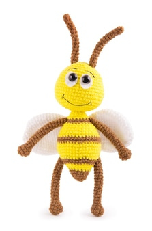 Soft knitted toy bee on a white