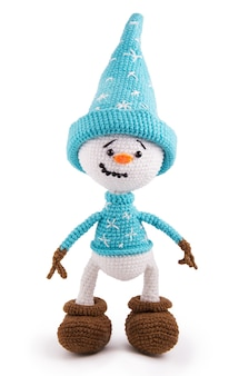 Soft knitting toy snowman on a white