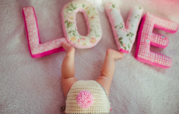 Soft letters love lie before child's legs