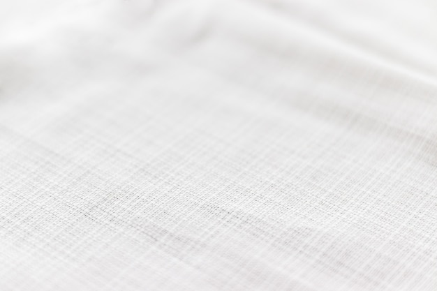 Soft light gray natural linen texture with focus at the bottom. crumpled fabric background. selective focus. closeup view