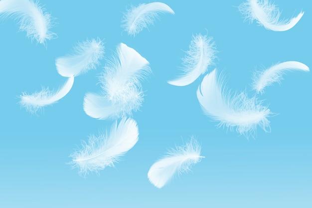 Мягкая легкость белых перьев, парящих в небе перо, летающих в небесах