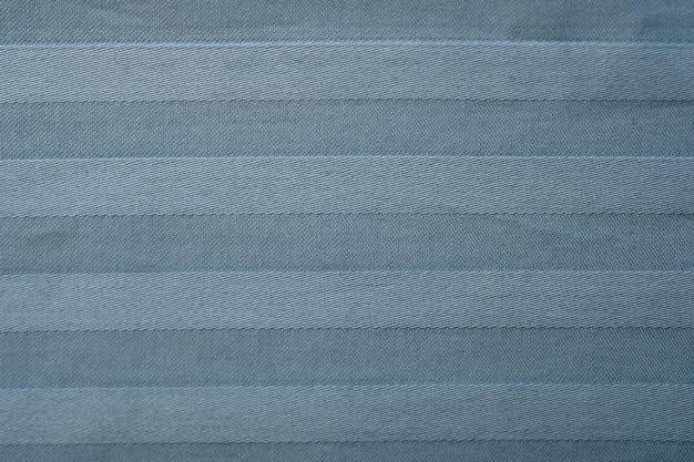 ジャカード織りのテクスチャのクローズアップと柔らかいパステルサテン。