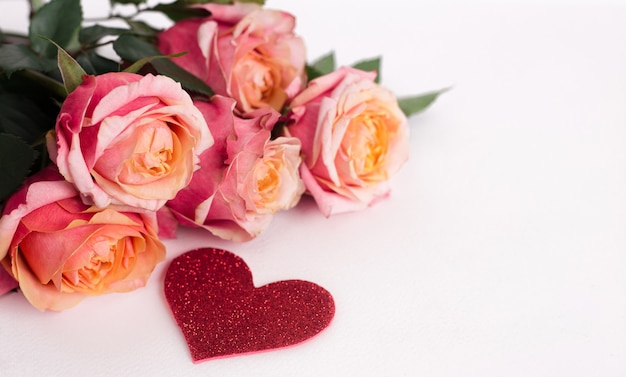 Soft pink roses and heart