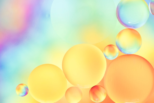 Soft rainbow bubbly abstract background