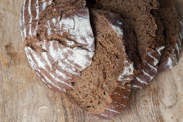 Soft rye bread with a crisp crust, fresh and delicious rye bread made from rye flour , divided into parts, rye fresh loaf of bread